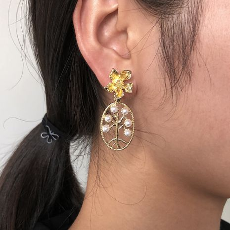 hot sale  hollow pearl flower earrings simple retro earrings wholesale wholesale NHMD250794's discount tags