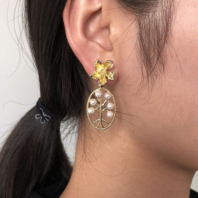 hot sale  hollow pearl flower earrings simple retro earrings wholesale wholesale NHMD250794