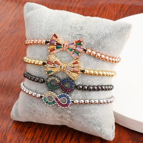Creative copper micro-inlaid color zircon bow hip-hop couple bracelets wholesale nihaojewelry NHJE240407's discount tags