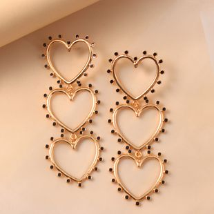fashion exaggerated creative heart-shaped drop oil  simple retro hollow love long tassel earrings wholesale nihaojewely NHKQ240475's discount tags