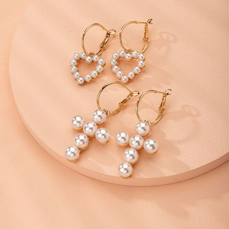 Korea pearl 925 silver needle love cross exquisite earrings wholesale nihaojewelry NHAI240628's discount tags