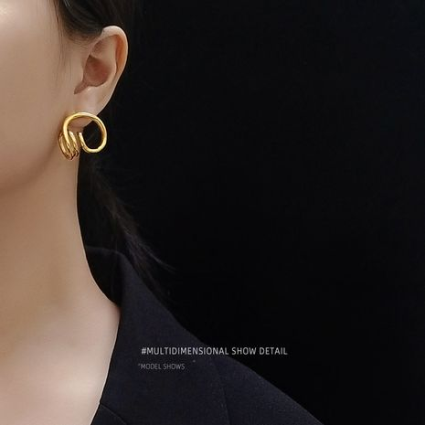 special-shaped cochlear inspiration steel material plated 18K real gold earrings wholesale NHOK250961's discount tags