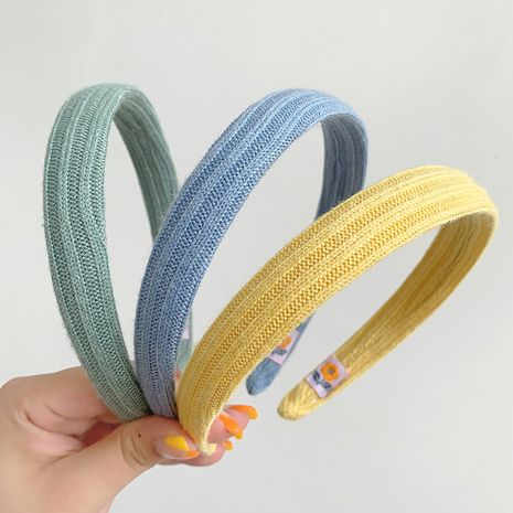 Korean simple wide-brimmed knitted color headband wholesale NHOF251152's discount tags