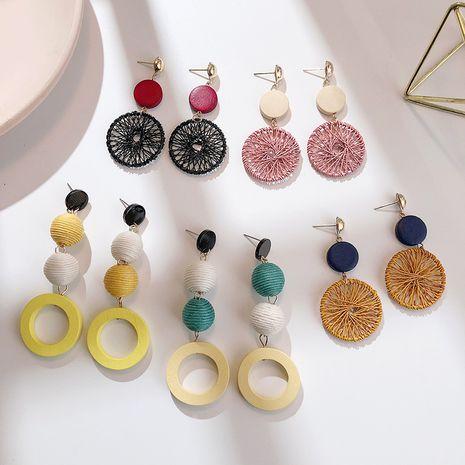 Korean retro ethnic wooden tassel fashion creative hollow round pendant long earrings wholesale NHPF251178's discount tags