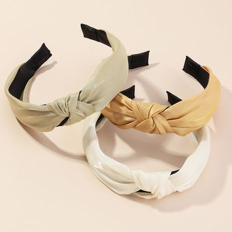 Simple wide-sided knotted fashion new pure color fabric pearlescent ladies headband wholesale NHAU240859's discount tags
