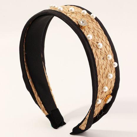 Moda nueva diadema de ratán perla anudada salvaje simple para mujeres al por mayor NHAU240867's discount tags
