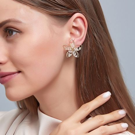 Korean hollow crystal flower hand-wrapped three-dimensional flower silver needle alloy women's earrings  NHDP240773's discount tags