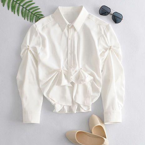 Moda nicho hebilla de perla dobladillo irregular simple pequeña camisa corta al por mayor NHAM241380's discount tags