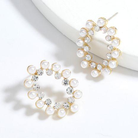 Boucles d'oreilles de fille de perles incrustées de diamants en alliage ovale simples en gros nihaojewelry NHJE241390's discount tags
