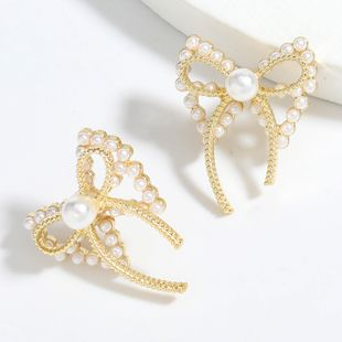 simple alloy inlaid pearl bow earrings wholesale nihaojewelry NHJE241394's discount tags
