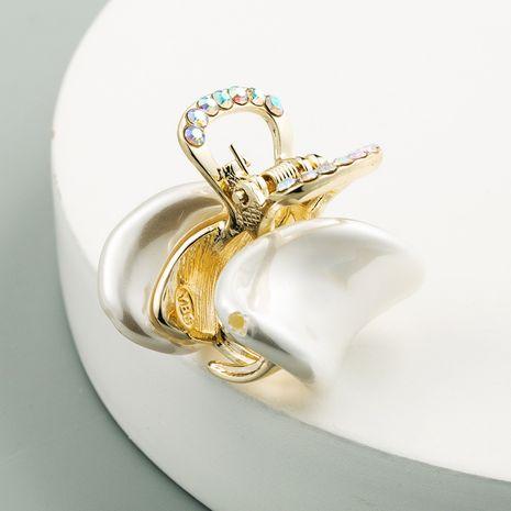 Nouvelle vente chaude mode perle strass clip queue de cheval clip all-match alliage griffe clip gros nihaojewelry NHLN241404's discount tags