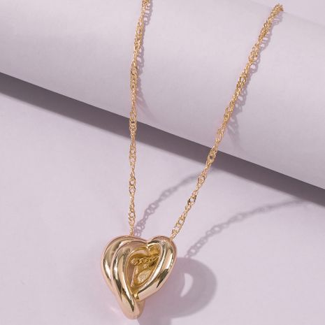 tendance de la mode collier pendentif en forme de coeur irrégulier collier plaqué or cuivre simple en gros nihaojewelry NHMD241641's discount tags