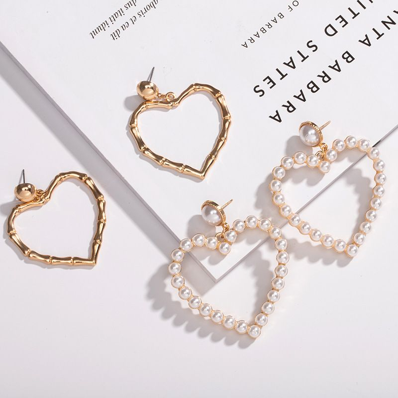 new fashion retro exaggerated peach heart love-shaped pearl hollow earrings for women NHAI241784