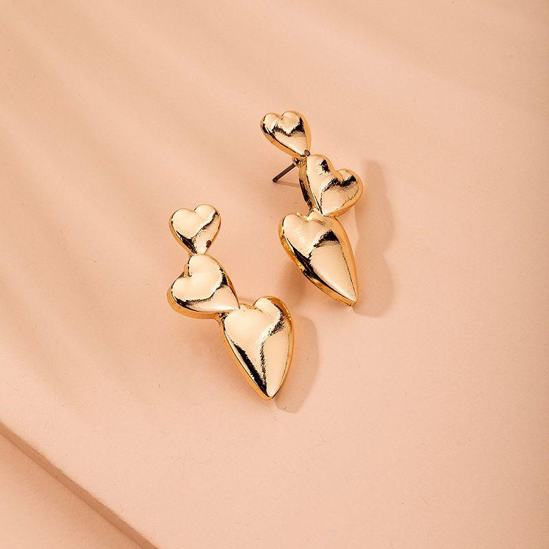 fashion love-shaped exaggerated peach heart metal retro earrings for women wholesale NHAI241805