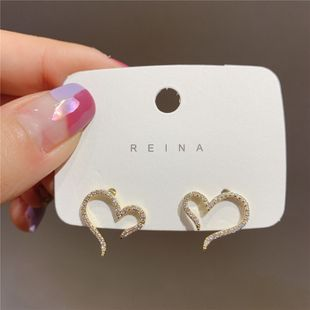 S925 Silver Needle Korea Simple Hollow Love-shaped Fashion women's alloy Earrings NHXI241850's discount tags