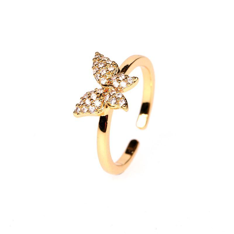 Nouvelle bague papillon en cuivre incrust d39or vritable bague ouverte en zircon en gros nihaojewelry NHPY241976