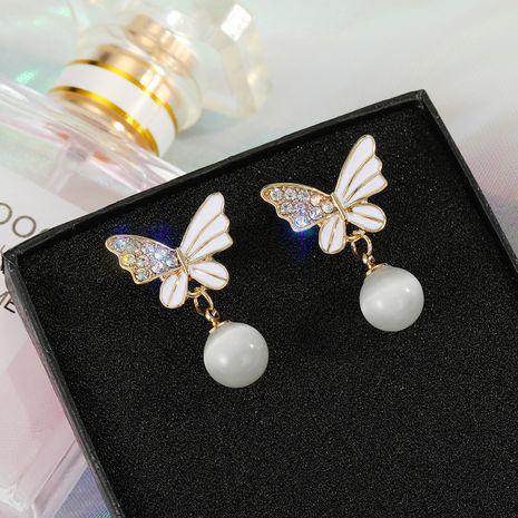 Boucles d'oreilles papillon blanc perle en argent 925 en gros nihaojewelry NHGO242113's discount tags