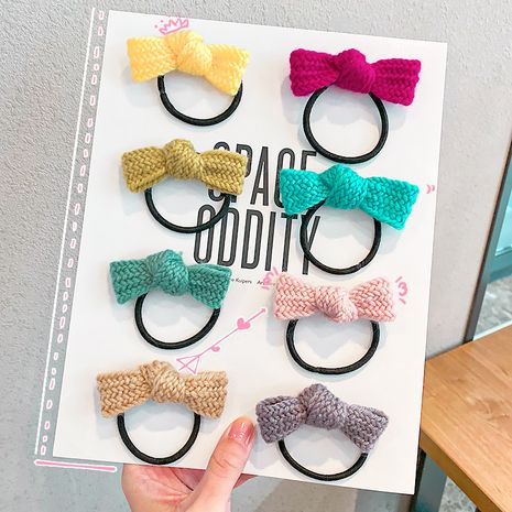 Korean wool bow knot cute girl hair tie autumn new color hair rope rubber band hair accessories NHNA251431's discount tags