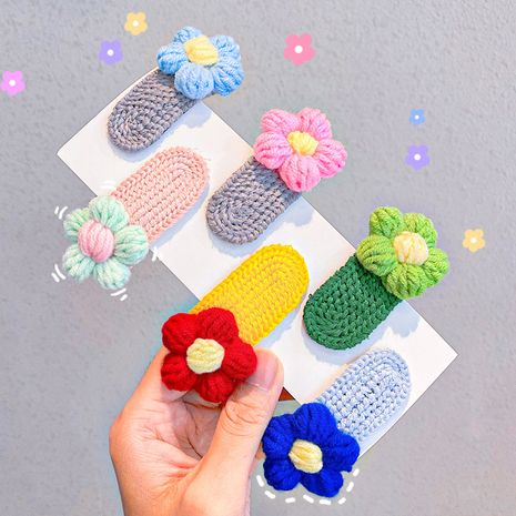 Korean autumn and winter new wool hairpin flower braided candy color hairpin wholesale NHNA251449's discount tags