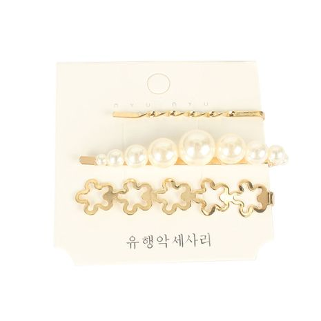 Bohemian style retro alloy inlaid pearl word clip hair clip wholesale NHCT251498's discount tags