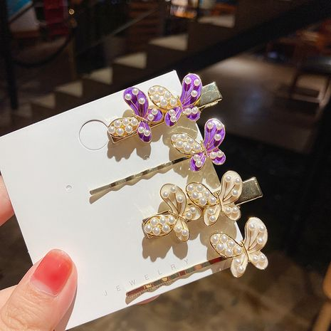 Simple pearl butterfly hairpin side clip girl 2-piece set of word clip wholesale NHMS251590's discount tags
