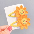 NHNA1046554-4A-pair-of-yellow-sunflower-hairpins