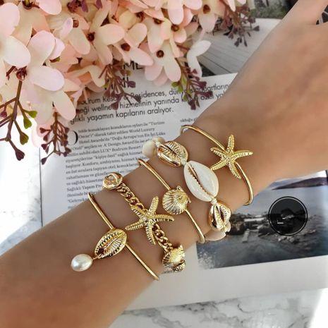 Hecho a mano concha trenzada estrella de mar pulsera de perlas moda popular de las mujeres nuevo estilo bangel al por mayor NHAJ251756's discount tags