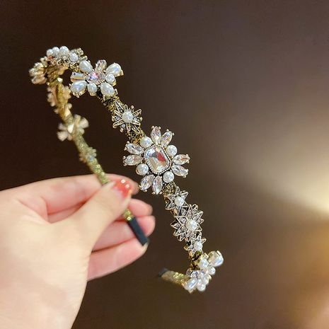 Korean retro baroque rhinestone pearl rhinestone flower gold wire headband wholesale NHMS256084's discount tags