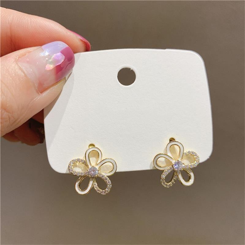 Korea Hollow Diamond Small Flowers 925 Silver Needle Three-dimensional Fairy Earrings For women NHXI256218
