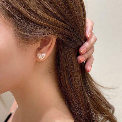 petites boucles d'oreilles simples coréennes en forme d'amour en forme d'amour en argent 925 NHXI256226's discount tags