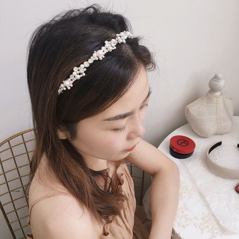 Korean retro simple bead flower  fine headband  wholesale NHHI256304's discount tags