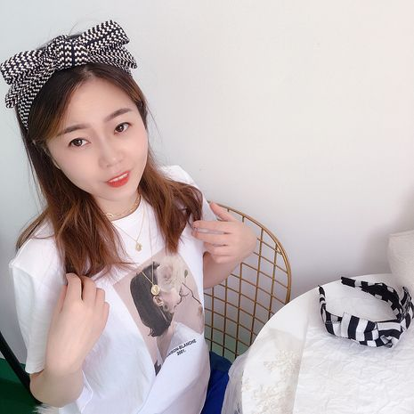 Korean new plaid bow knotted multi-layer headband wholesale NHHI256308's discount tags
