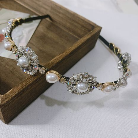 Korea's new style retro baroque handmade pearl rhinestone headband wholesale NHYQ256333's discount tags