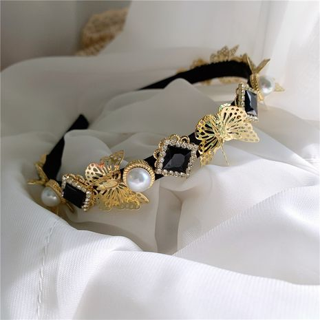 Retro Palace Rhinestone Metal Three-dimensional Butterfly Pearl Headband wholesale NHYQ256342's discount tags