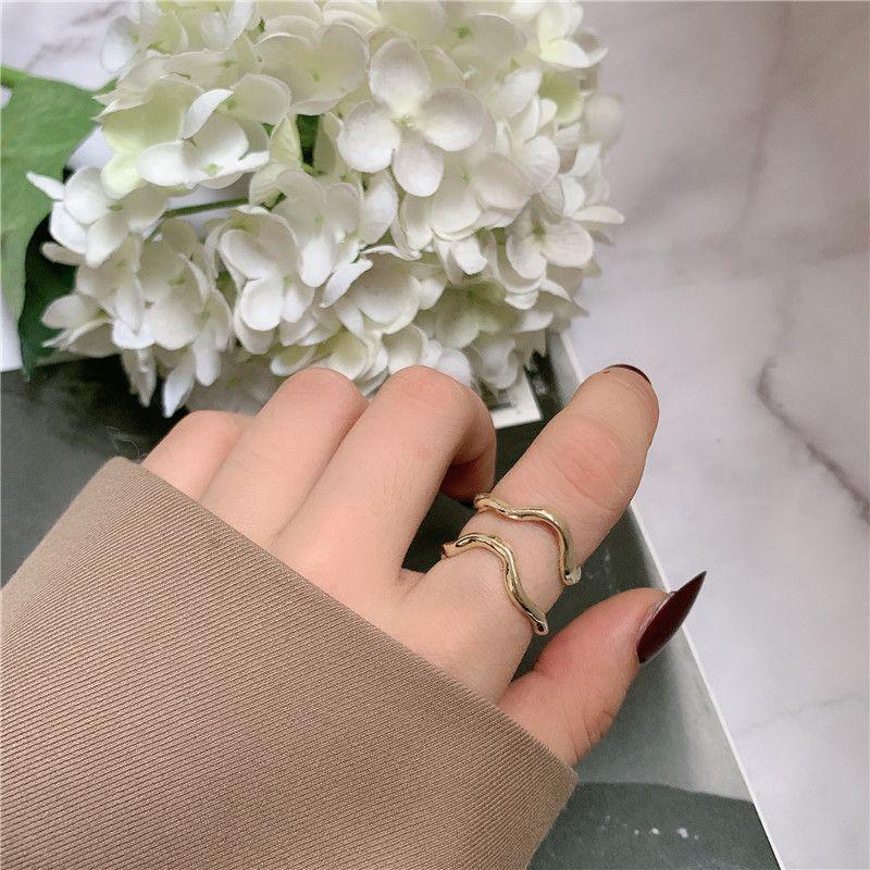 Fashion curved geometric lines irregular ring NHYQ256551