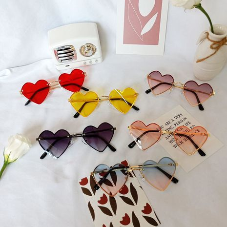 New children's rimless sunglasses girls heart-shaped personality anti-UV glasses  NHBA256732's discount tags