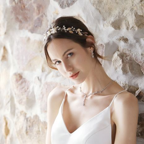 Fashion new bridal hand-woven simple pearl golden leaf headband NHHS256499's discount tags