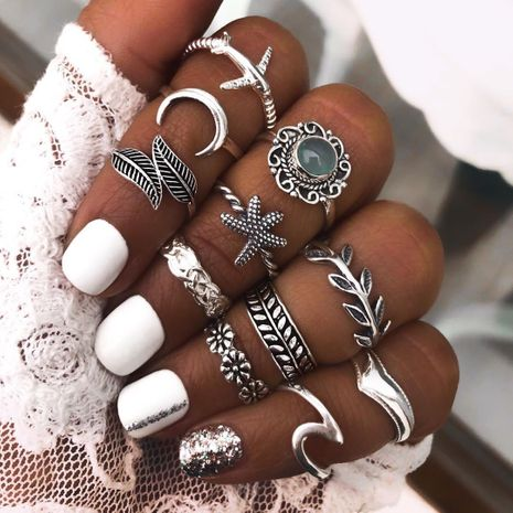 new retro combination fashionable diamond carved star ring set wholesale NHBQ256921's discount tags