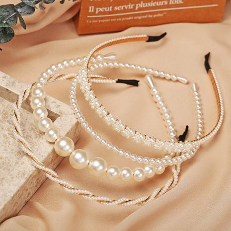 Hot selling faux pearl headband creative retro fashion pearl headband NHYI256898's discount tags