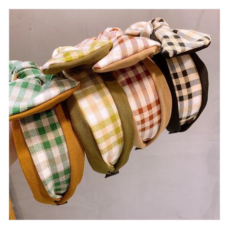 Korean  retro college style British plaid stitching bow headband  NHHD257223's discount tags