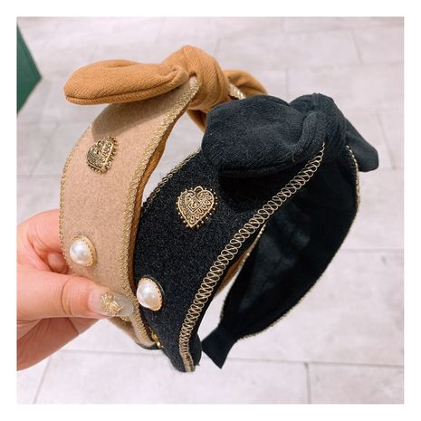 Baroque beauty head woolen bow wild hair band wholesale  NHHD257228's discount tags