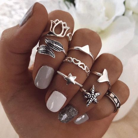 Hot selling fashion personality star ring fishtail leaf rings set NHBQ257505's discount tags