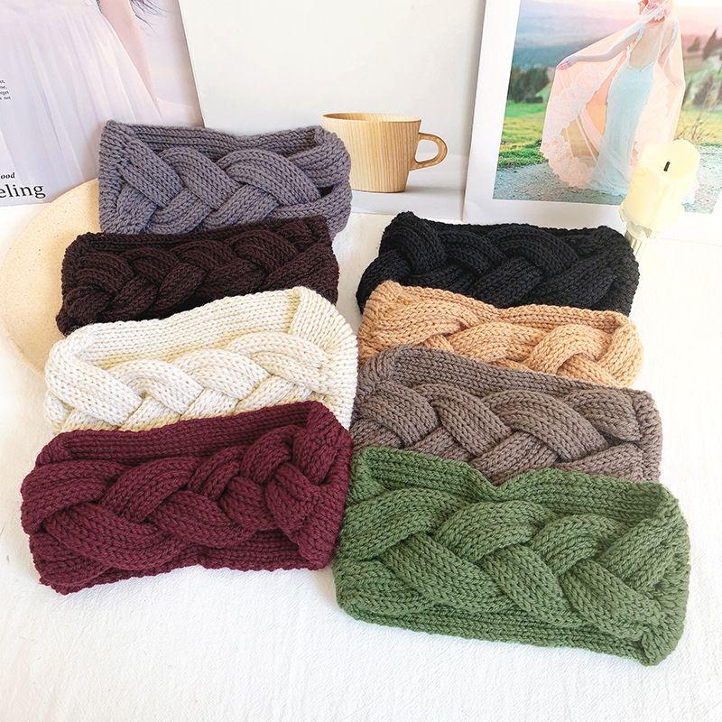 Fashion twist knitting wool cross headband sports sweat-absorbent yoga headband  NHOF257425
