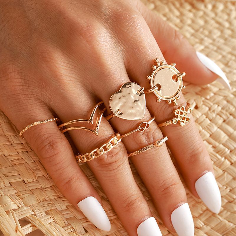 Hot selling Golden personality disc love Chinese knot ring geometric chain heart-shaped 8-piece ring NHGY257438