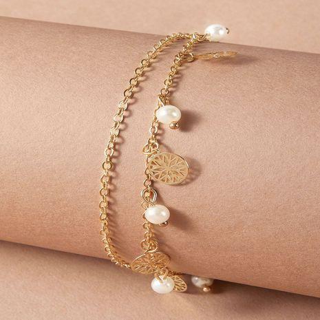 Ensemble de 2 pièces de cheville à pompon à fleurs creuses rondes à la mode simple nouvelle perle douce NHGY257470's discount tags