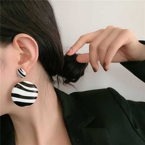 Korean long black and white striped leather round silver needle long earrings wholesale NHYQ257963's discount tags