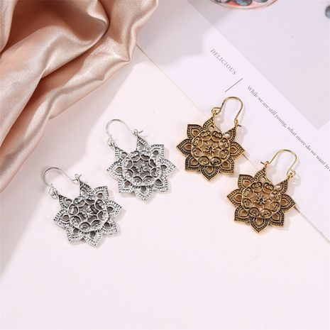 new bohemian metal carved retro hollow flowers ear buckle earrings wholesale NHMO258044's discount tags