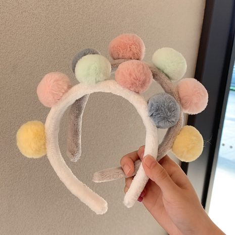 Korean candy-colored headdress wash headband cute non-slip hairband wholesale NHDQ258195's discount tags