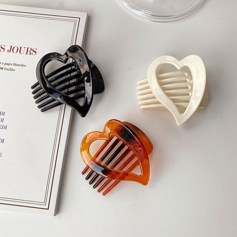 Korea new acrylic comb-shaped love catching clip hairpin heart-shaped head jewelry wholesale NHDQ258199's discount tags