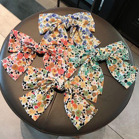 Doux floral arc printemps clip fille épingle à cheveux pastorale vacances style épingle à cheveux en gros NHDQ258201's discount tags